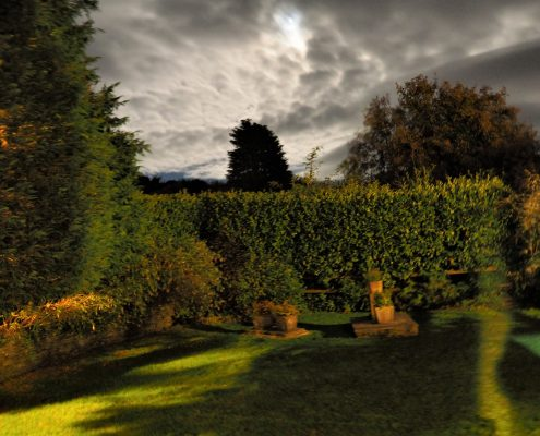 Sunset over Rafters garden at Dittiscombe Holiday Cottages